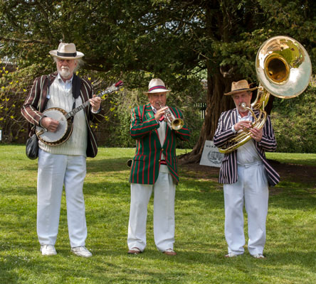The Jazz Magic Trio performing in the gardens on a beautiful sunlit afternoon